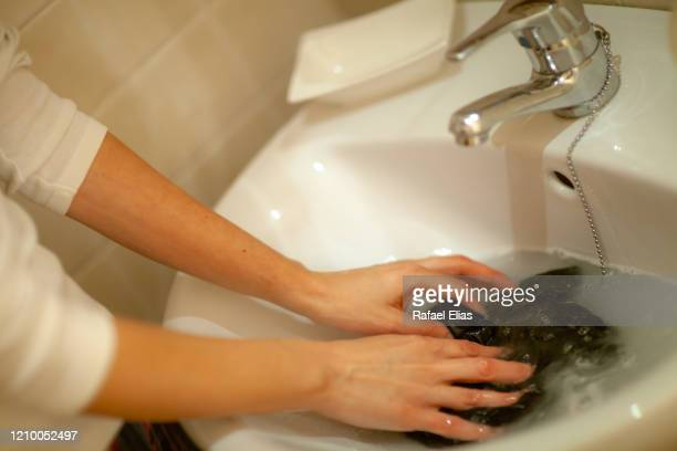 woman hands washing clothes in the bathroom - wet knickers stock pictures, royalty-free photos & images