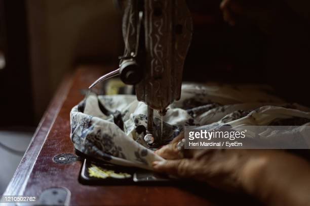 woman hands working on a old sewing machine - heri mardinal stock pictures, royalty-free photos & images