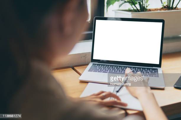 woman hands working with blank screen laptop computer mock up.hands at work with digital technology.working on desk environment.planing and working with mobile device screen template. - one person stock pictures, royalty-free photos & images