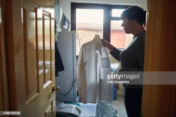 Woman hanging a white shirt