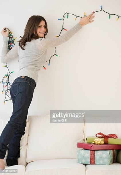 Woman hanging Christmas lights