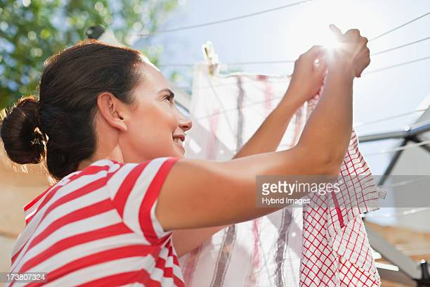 woman hanging clothes up on line - hanging stock pictures, royalty-free photos & images