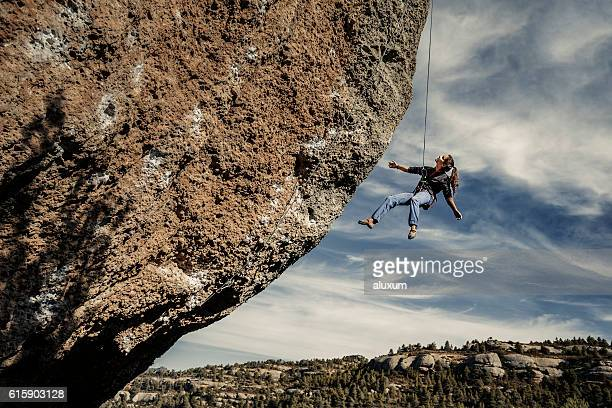 Woman hanging from rope