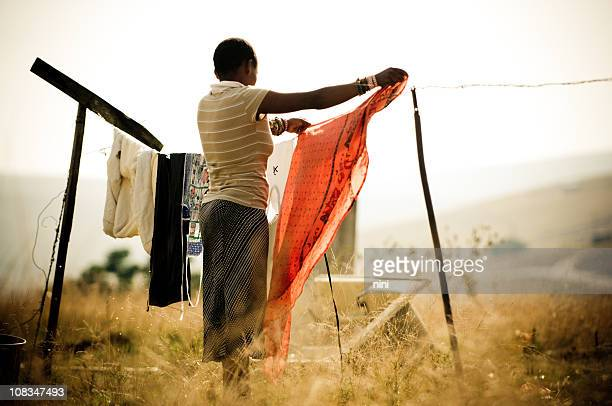Woman hanging laundry in rural Africa