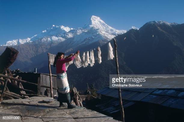 Woman Hanging Laundry Near Annapurna