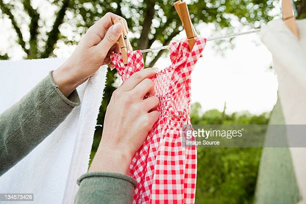 woman hanging laundry on clothesline - checked dress stock pictures, royalty-free photos & images