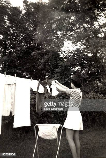 Woman hanging out washing England 1960s