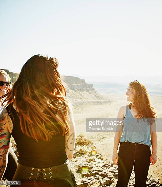 Woman hanging out with friends during road trip