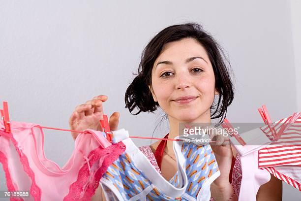 a woman hanging underwear on a clothesline - calcinha - fotografias e filmes do acervo