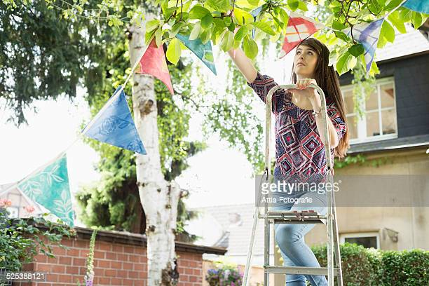 Woman hanging up bunting