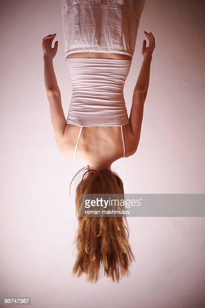 Woman hanging upside down