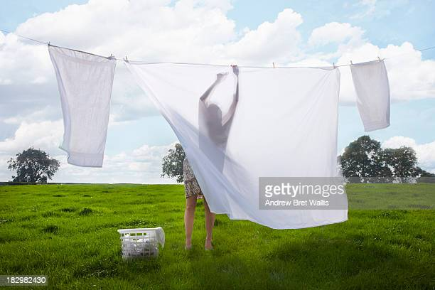 Woman hanging washing on a clothes line