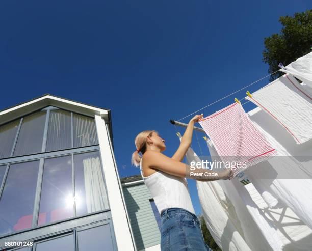 woman hanging washing on line - 乾かす ストックフォトと画像