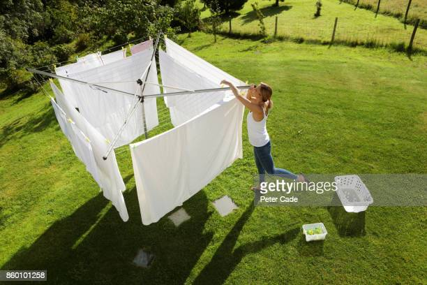 woman hanging washing on line - drying stock pictures, royalty-free photos & images