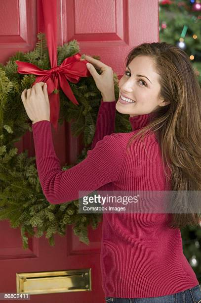Woman hanging wreath