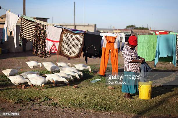 Woman hangs washing in the New Brighton Township on June 24, 2010 in Port Elizabeth, South Africa. The New Brighton Township was established in 1903,...