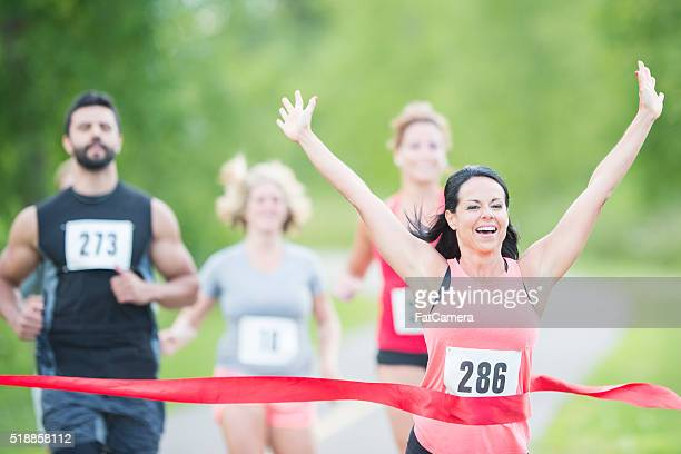 Woman Happily Crossing the Finish Line
