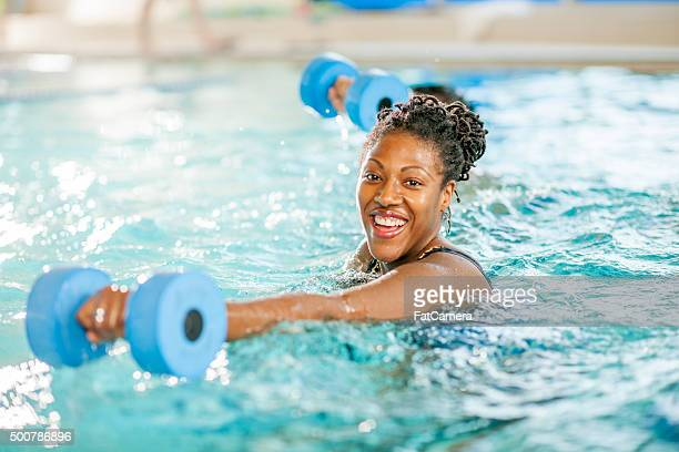 Woman Happily Working Out in the Pool