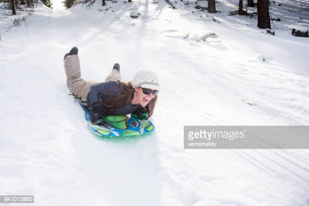 Woman Happiness in Nature Sledding