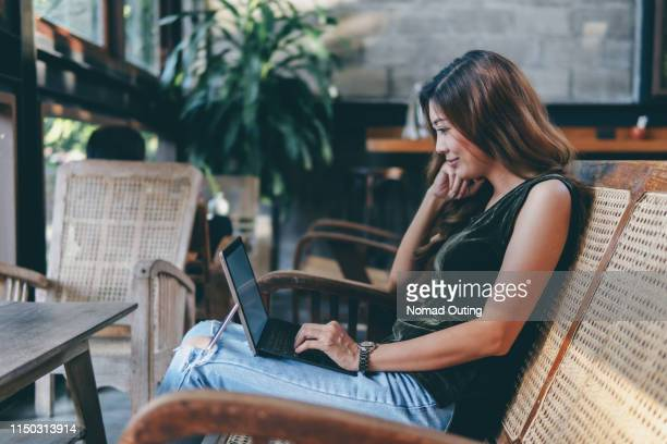 woman happy looking and using laptop computer.business working people with casual clothing.smart business casual attire.modern business look concept. - laptop mockup stock photos and pictures