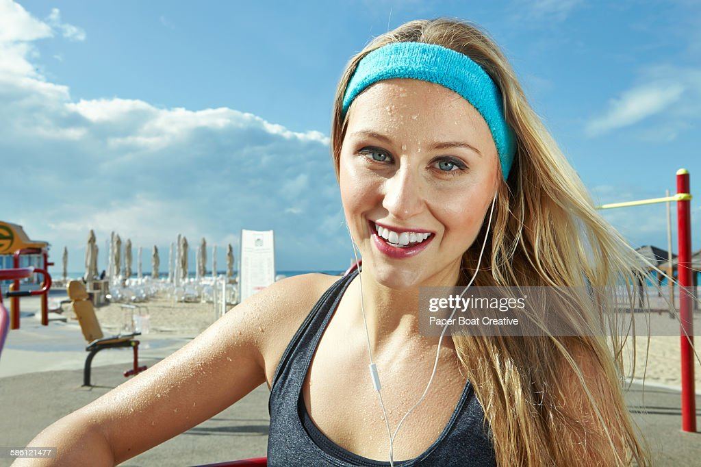 Woman happy right after a hard workout : Stock Photo