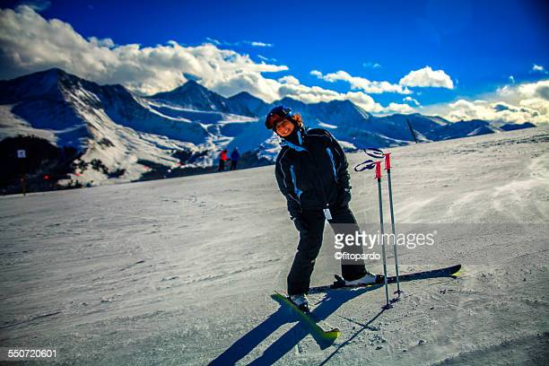 Woman happy standing and waiting in a ski point