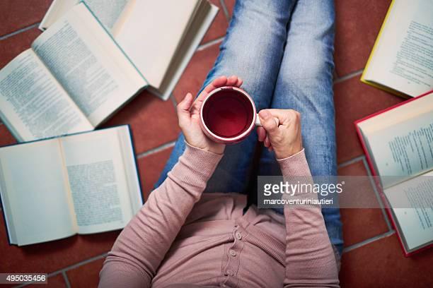 Woman has a break from reading