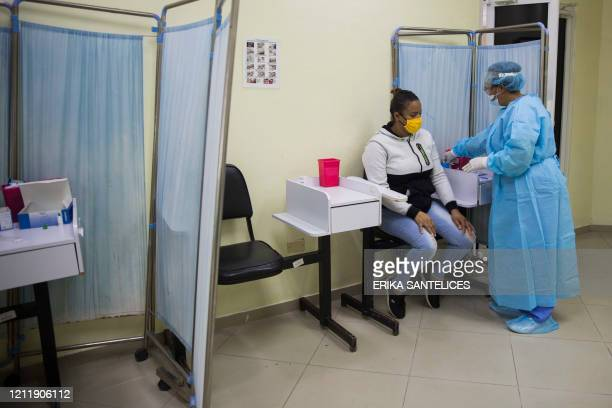 Woman has a rapid test for COVID-19 at the Regional University Hospital Doctor Luis Manuel Morillo King in La Vega, in the Dominican Republic, on May...