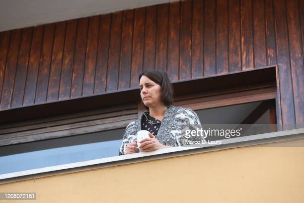 A woman has coffee on her home balcony on March 22 2020 in Rome Italy As Italy extends its nationwide lockdown to control the spread of COVID19 its...