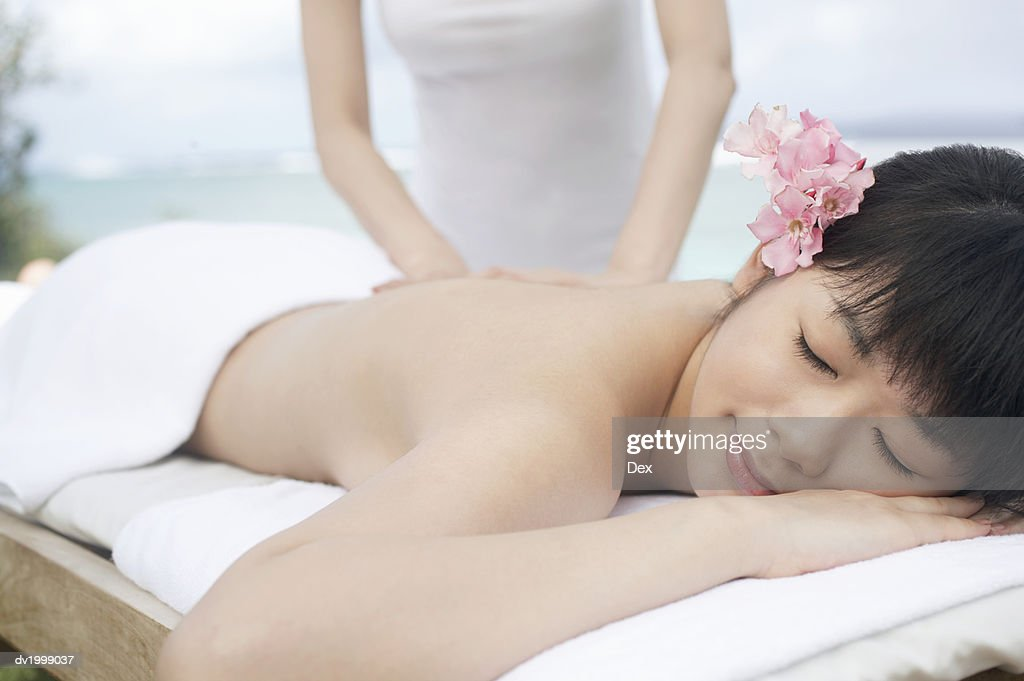 Woman Has Her Back Massaged : Stock Photo