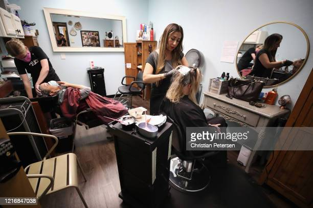 A woman has her hair colored by cosmetologist Nikki Cannon at The Beauty Studios on April 04 2020 in Glendale Arizona Arizona Gov Doug Ducey expanded...