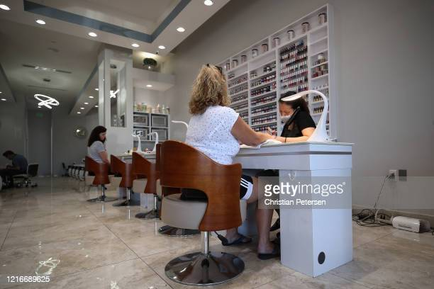 A woman has her nails polished by a cosmetologist at Avalon Nails on April 03 2020 in Glendale Arizona Arizona Gov Doug Ducey expanded his statewide...