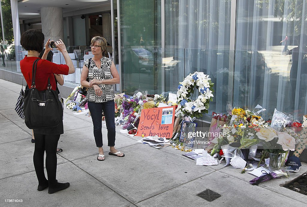 A woman has her photo taken in front of a memorial to deceased actor Cory Monteith outside the Fairmont Pacific Rim Hotel on July 16, 2013 in Vancouver, British Columbia, Canada. The B.C. Coroners Service released results of Monteith's autopsy today and found the 31-year-old's cause of death was a mixed drug toxicity involving heroin and alcohol.