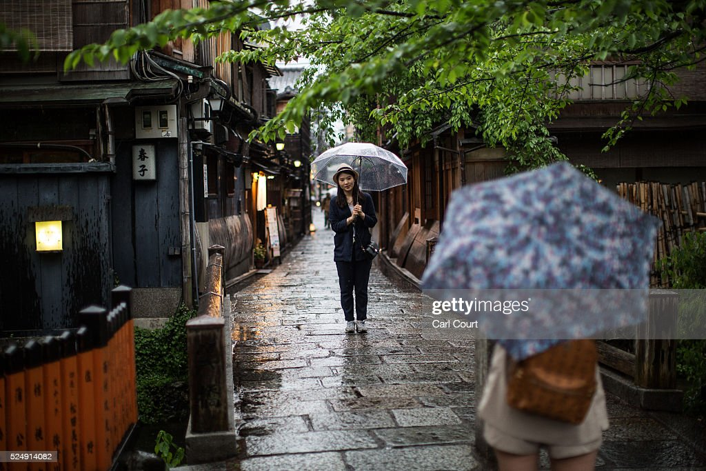 A woman has her photograph taken in a narrow lane on April 27, 2016 in Kyoto, Japan. Now the seventh largest city in Japan, Kyoto was once the Imperial capital for more than one thousand years, it is now the capital city of Kyoto Prefecture and a major part of the Kyoto-Osaka-Kobe metropolitan area.