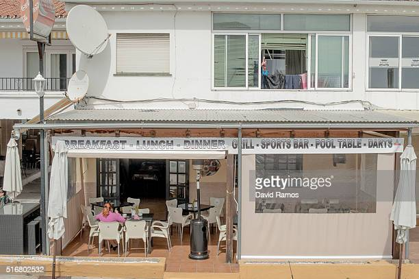 A woman has lunch at an English bar on March 18 2016 in Mijas Spain Spain is Europe's top destination for British expats with the southern regions of...