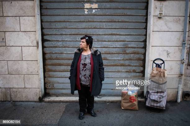 A woman has received a food bag from the members of Farright movement Casapound in Ostia suburb of Rome on November 1 2017 in Rome Italy Ostia's city...