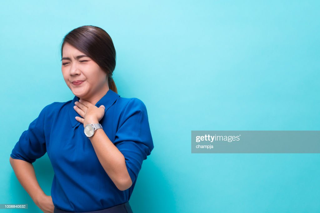Woman has sore throat : Stock Photo