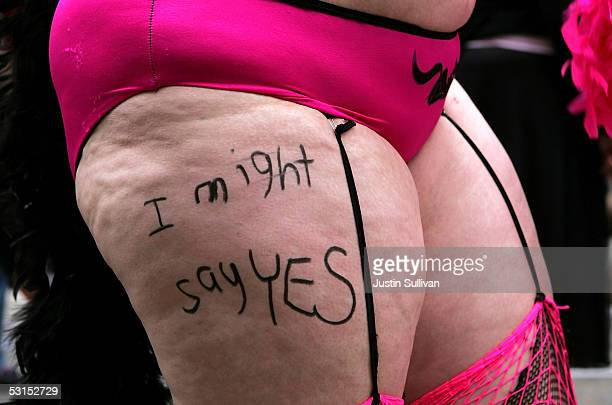 """Woman has the words """"I might say yes"""" written on her leg as she participates in the 2005 San Francisco Pride Parade June 26, 2005 in San Francisco,..."""