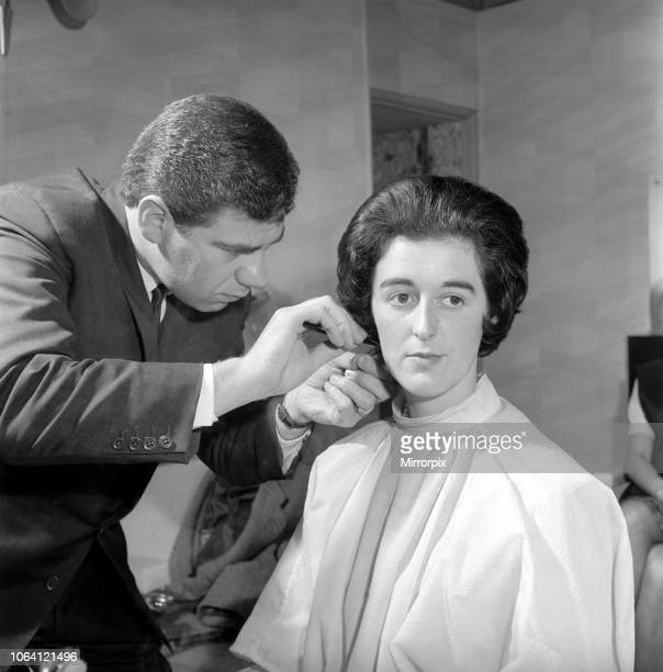 Woman have her hair cut and curled at the hair dressers 7th June 1962