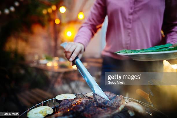 woman having a barbecue outdoor. - grillen stock-fotos und bilder