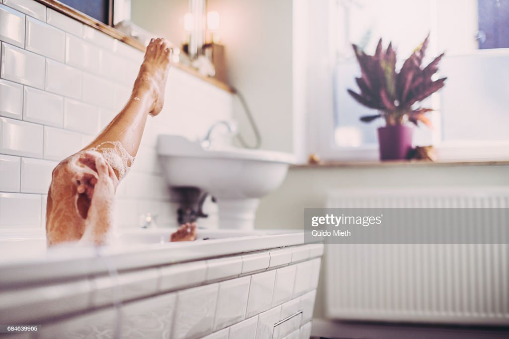 Woman having a bath. : Stock Photo