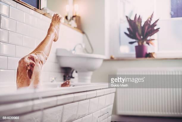 Woman having a bath.