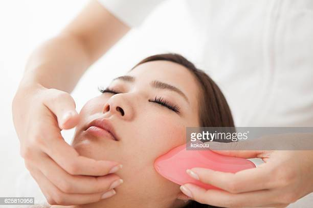 Woman having a face massaged for beauty
