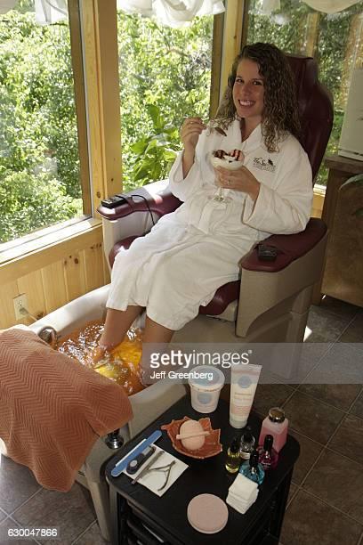 Woman having a footbath at The Spa at Oak Haven.