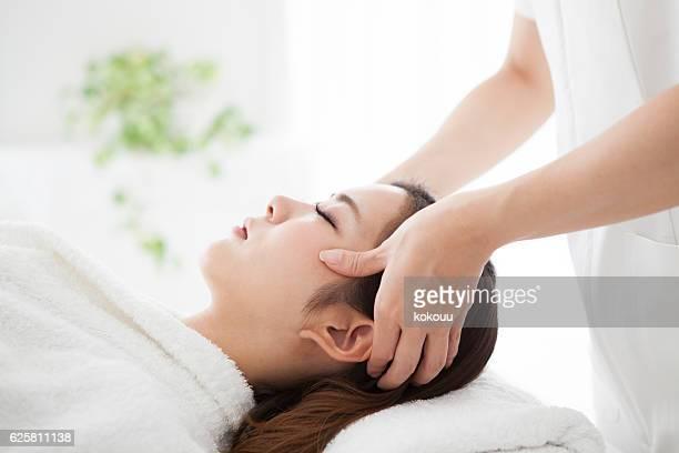 Woman having a head massage for beauty