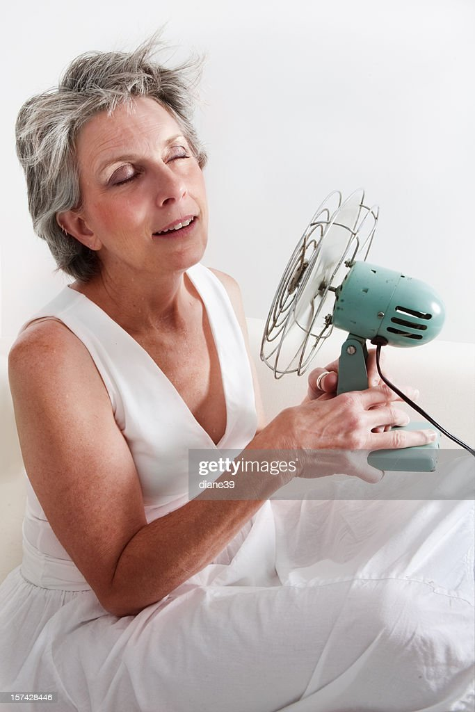 woman having a hot flash : Stock Photo