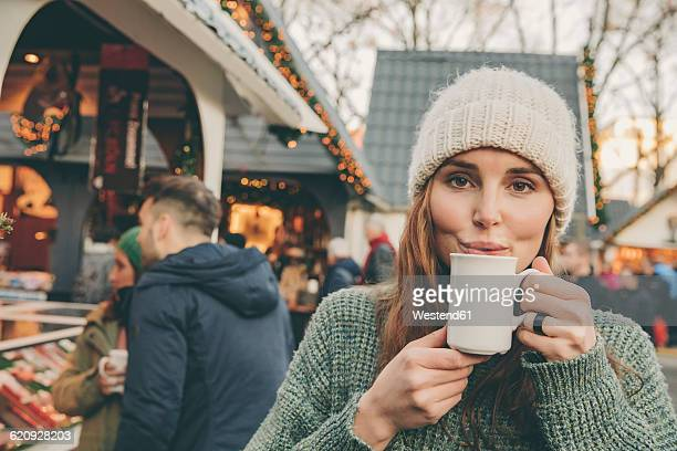Woman having a hot punch on the Christmas Market