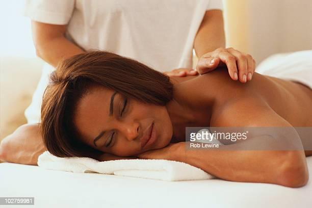 woman having a massage - erotische massage stock-fotos und bilder