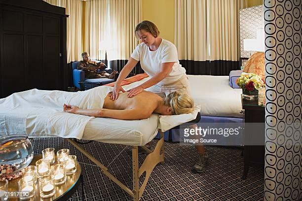 woman having a massage - massage room photos et images de collection