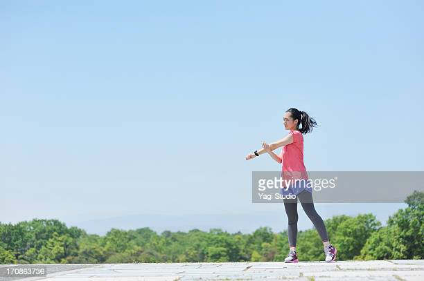 woman having a warm-up for a run. - sports ストックフォトと画像